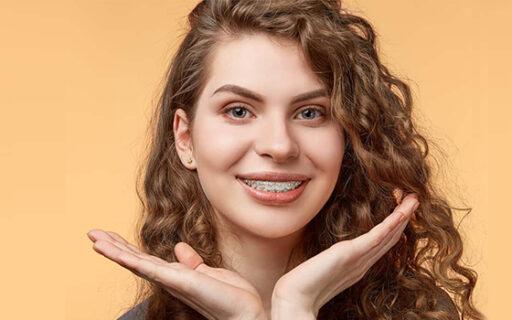 girl wearing metal braces | Whites Dental