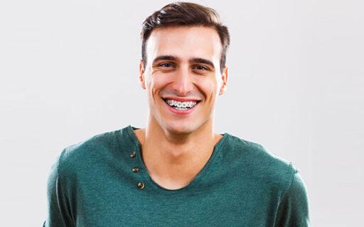 man wearing metal braces | Whites Dental