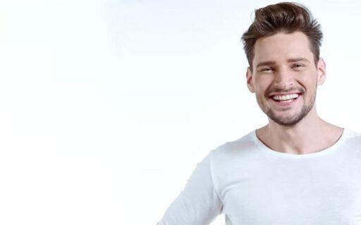 smiling man with teeth showing |Whites Dental