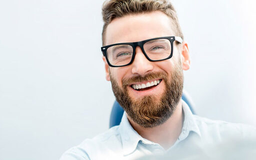a smiling man with teeth showing | Whites Dental