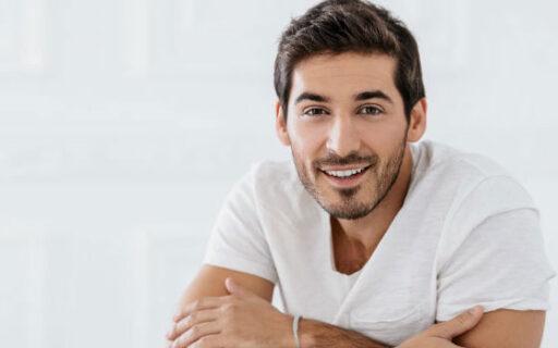 smiling man with teeth showing | Whites Dental