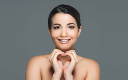 smiling woman with teeth showing | Whites Dental